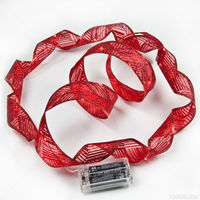 6 ft. Lighted Length - 1.5 in. Width - RED Ribbon - (18) RED LEDs - 4 in. Battery Lead Wire