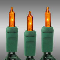 50 ft. Christmas String Lights - (100) Amber-Orange Mini Lights - 6 in. Bulb Spacing - Green Wire - 40 Watt - Commercial Duty - 5 Set Max. Connection - Male to Female Connection - 120V